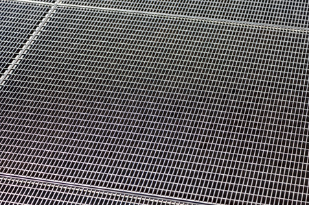 metal grate: Metal grill texture with holes as background