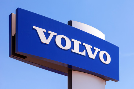 automaker: SAMARA, RUSSIA - MAY 31, 2014: Volvo dealership sign against blue sky. Volvo is a Swedish multinational automaker company headquartered in Gothenburg, Sweden