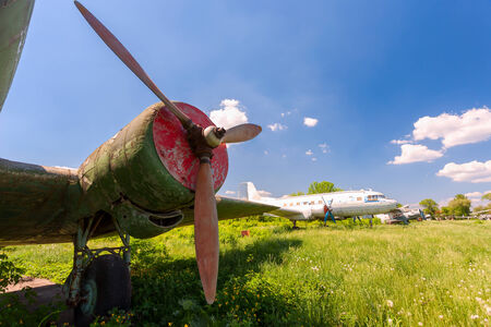 aerodrome: SAMARA, RUSSIA - MAY 25, 2014: Old russian turboprop aircraft at an abandoned aerodrome in summertime