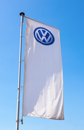 automaker: SAMARA, RUSSIA - MAY 31, 2014: The flag of Volkswagen over blue sky. Volkswagen is the biggest German automaker and the third largest automaker in the world