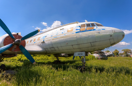 turboprop: SAMARA, RUSSIA - MAY 25, 2014: Old russian turboprop aircraft Il-14M at an abandoned aerodrome in summertime Editorial