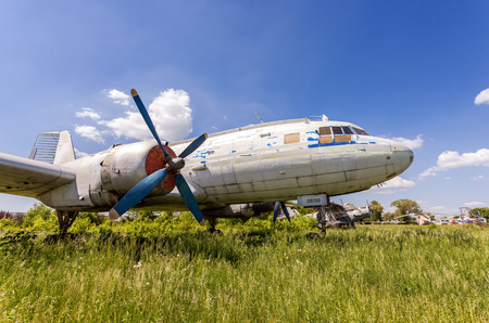 aerodrome: SAMARA, RUSSIA - MAY 25, 2014: Old russian turboprop aircraft Il-14M at an abandoned aerodrome in summertime Editorial