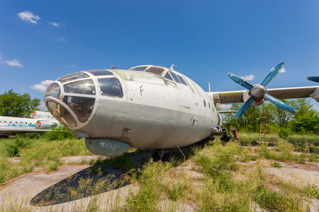 aerodrome: SAMARA, RUSSIA - MAY 25, 2014: Old russian aircraft An-12 at an abandoned aerodrome. The Antonov An-12 is a four-engined turboprop transport aircraft designed in the Soviet Union