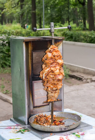 Shawarma is one of the most popular fast food dish in Middle Eastern Countries photo