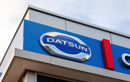 SAMARA, RUSSIA - AUGUST 30, 2014: Datsun dealership sign against blue sky. Datsun is an automobile brand owned by the Nissan Motor Company