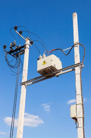 isolators: Transformer on high power station against blue sky background Stock Photo