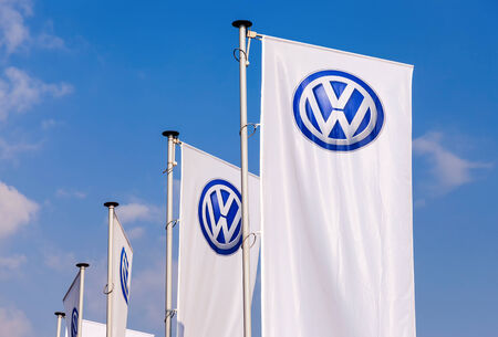 automaker: SAMARA, RUSSIA - SEPTEMBER 21, 2014: The flags of Volkswagen over blue sky. Volkswagen is the biggest German automaker and the third largest automaker in the world Editorial