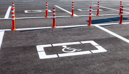 Parking space reserved for handicapped shoppers in a retail parking lot photo