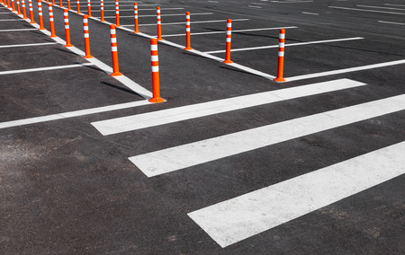 White traffic markings with a pedestrian crossing on a gray asphalt parking lot Stock Photo - 32101265