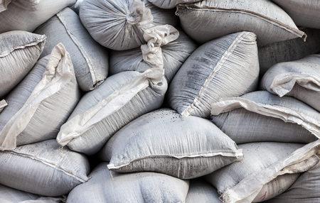 Wall of sandbags for flood defense or military use photo
