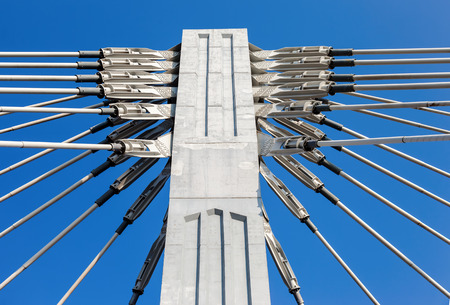 bridge construction: Pillar of cable bridge against blue sky