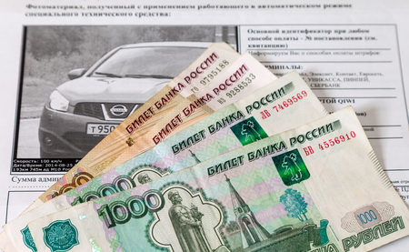 violating: SAMARA, RUSSIA - OCTOBER 9, 2014: Receipt for payment of a fine for violation of traffic rules and money