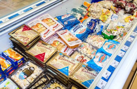 BOROVICHI, RUSSIA - JULY 11, 2014: Showcase with frozen products in supermarket Dixy. Dixy is Russias third largest food retail company