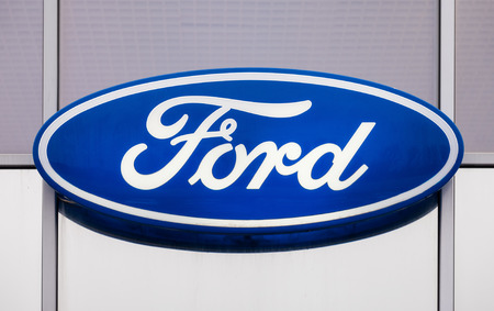 automaker: SAMARA, RUSSIA - NOVEMBER 8, 2014: The emblem Ford on the office of official dealer. Ford Motor Company is an American multinational automaker headquartered in Dearborn, Michigan, US Editorial