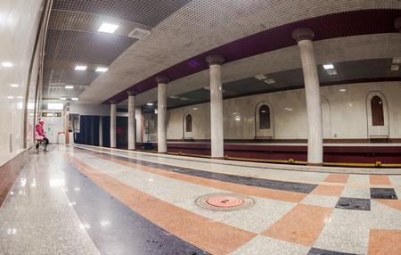 await: SAMARA, RUSSIA - DECEMBER 20, 2014: Passenger await the arrival of the train at subway station Rossiyskaya