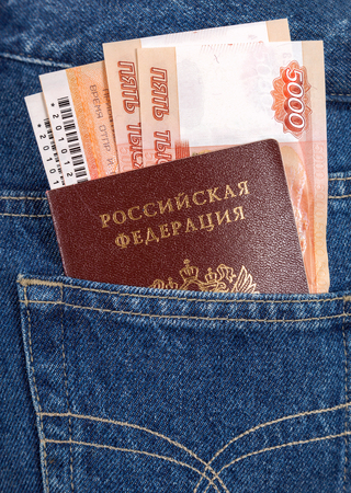 SAMARA, RUSSIA - SEPTEMBER 16, 2013: Russian rouble bills, train tickets  and passport in the back jeans pocket