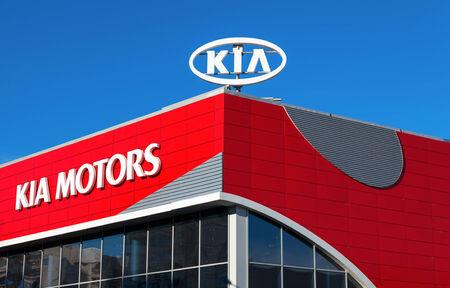 headquartered: SAMARA, RUSSIA - OCTOBER 20, 2013: The emblem KIA motors on blue sky background. Kia Motors is South Koreas second-largest automobile manufacturer