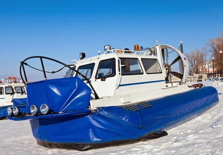 thin ice: SAMARA, RUSSIA - FEBRUARY 23, 2013: Hovercraft on the ice of the frozen Volga River in Samara