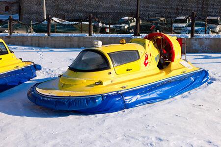 thin ice: SAMARA, RUSSIA - FEBRUARY 23, 2013: Hovercraft on the ice of the frozen Volga River in Samara near the Zhigulevsky brewery