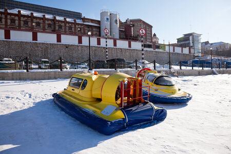 hovercraft: SAMARA, RUSSIA - FEBRUARY 23, 2013: Hovercraft on the ice of the frozen Volga River in Samara near the Zhigulevsky brewery