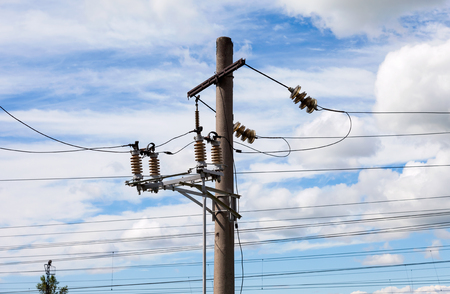 over voltage: High voltage electricity pylon over cloudy sky
