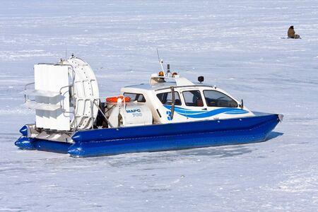 hovercraft: SAMARA, RUSSIA - FEBRUARY 23, 2013: Hovercraft on the ice of the frozen Volga River in Samara