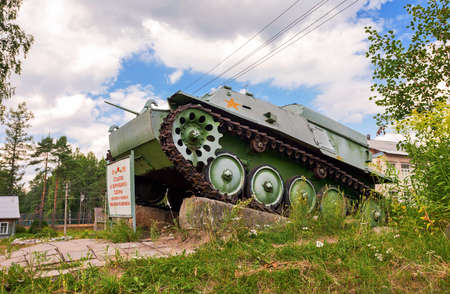 tracked: LUBYTINO, RUSSIA - MAY 2, 2013: Soviet light semi armored tracked artillery tractor AT-P  as monument