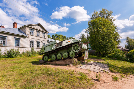 militarily: LUBYTINO, RUSSIA - MAY 2, 2013: Soviet light semi armored tracked artillery tractor AT-P  as monument