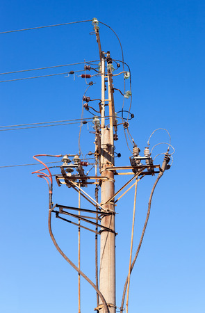 Power line wiring and insulators system over blue sky