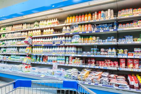 SAMARA, RUSSIA - FEBRUARY 7, 2015: Fresh milk produces ready for sale in Perekrestok Samara Store. Perekrestok is a Russian supermarket chain operated by X5 Retail Group