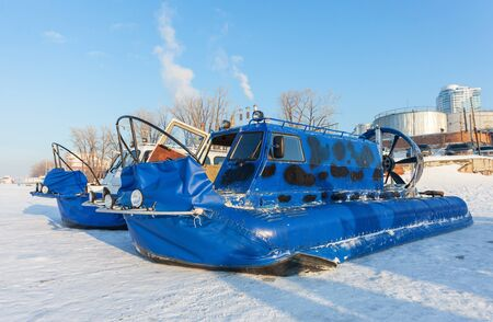 hovercraft: Hovercraft on the ice of the frozen river
