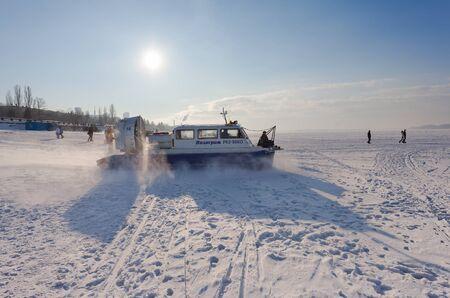 hovercraft: SAMARA, RUSSIA - FEBRUARY 14, 2015: Hovercraft on the ice of the frozen Volga River in Samara Editorial