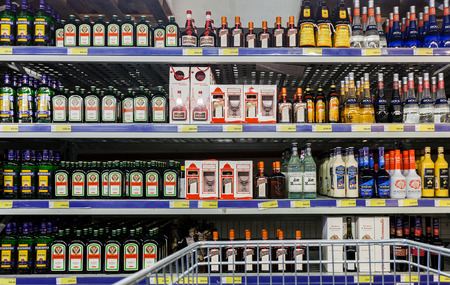 diversified: SAMARA, RUSSIA - FEBRUARY 15, 2015: Showcase alcoholic beverages at the hypermarket METRO. Metro Group is a German global diversified retailer Editorial