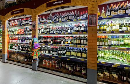 diversified: SAMARA, RUSSIA - FEBRUARY 15, 2015: Showcase alcoholic beverages at the hypermarket METRO. Metro Group is a German global diversified retailer Editorial