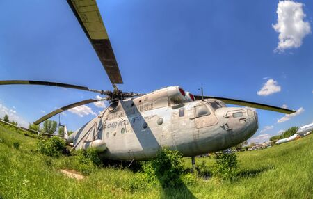 aerodrome: SAMARA, RUSSIA - MAY 25, 2014: The russian heavy transport helicopter Mi-6 at an abandoned aerodrome. The Mil Mi-6 was built in large numbers for both military and civil roles Editorial
