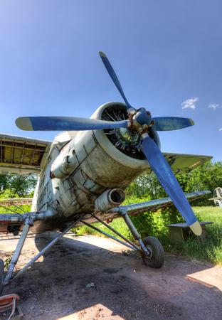 aerodrome: SAMARA, RUSSIA - MAY 25, 2014: The Antonov An-2 a Soviet mass-produced single-engine biplane at an abandoned aerodrome Editorial