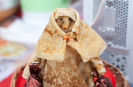 maslenitsa: Shrovetide effigy made of pancakes close up. Russian traditional food