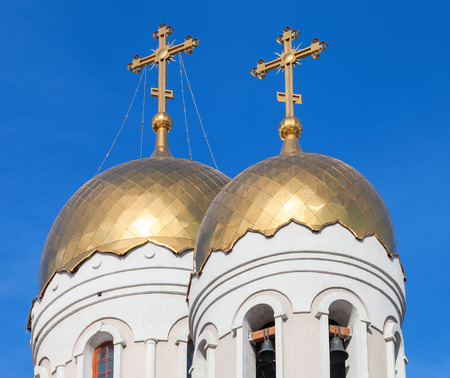 the orthodox church: Golden domes of Russian orthodox church with cross against blue sky