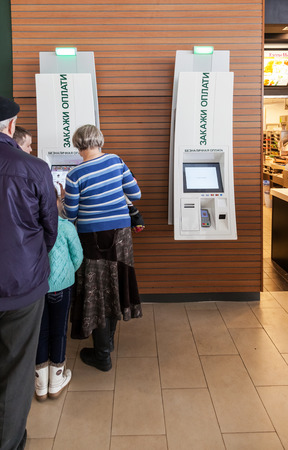 self operation: SAMARA, RUSSIA - MARCH 8, 2015: Self service terminal in McDonalds restaurant. The McDonalds Corporation is the worlds largest chain of hamburger fast food restaurants