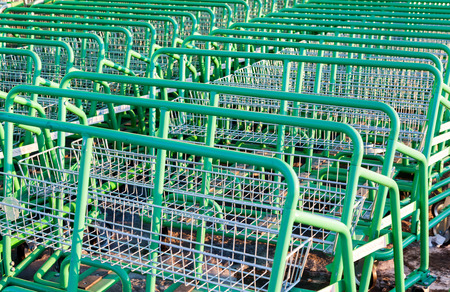 merlin: SAMARA, RUSSIA - MARCH 17, 2015: Large empty green shopping cart Leroy Merlin store. Leroy Merlin is a French home-improvement and gardening retailer serving thirteen countries Editorial