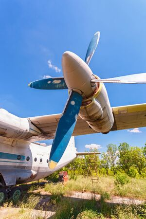 turboprop: SAMARA, RUSSIA - MAY 25, 2014: Turbines of turboprop aircraft An-12 at an abandoned aerodrome. The Antonov An-12 is a four-engined turboprop transport aircraft designed in the Soviet Union