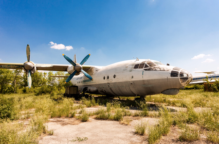 aerodrome: SAMARA, RUSSIA - MAY 25, 2014: Turboprop aircraft An-12 at an abandoned aerodrome. The Antonov An-12 is a four-engined turboprop transport aircraft designed in the Soviet Union Editorial