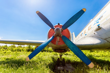 turboprop: Turbine of old russian turboprop aircraft at the abandoned aerodrome in summertime