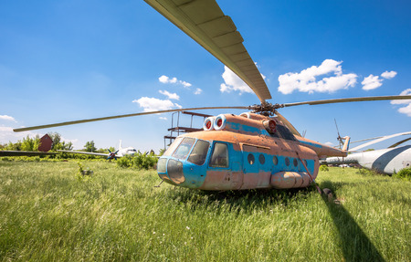 aerodrome: SAMARA, RUSSIA - MAY 25, 2014: The russian transport helicopter Mi-6 at an abandoned aerodrome. The Mil Mi-6 was built in large numbers for both military and civil roles Editorial