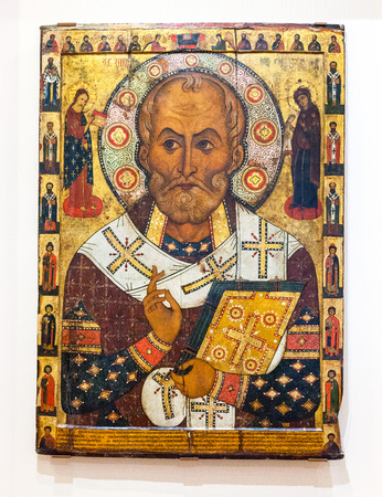 iconography: VELIKY  NOVGOROD, RUSSIA - JULY 24, 2014: Antique Russian orthodox icon of Saint Nicolas painted on wooden board Editorial
