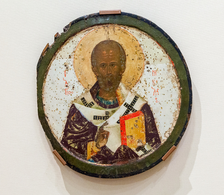 veliky: VELIKY  NOVGOROD, RUSSIA - JULY 24, 2014: Antique Russian orthodox icon of Saint Nicolas painted on wooden board Editorial