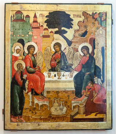 VELIKY  NOVGOROD, RUSSIA - JULY 24, 2014: Antique Russian orthodox icon The Old Testament Trinity painted on wooden board Stock Photo - 38458750