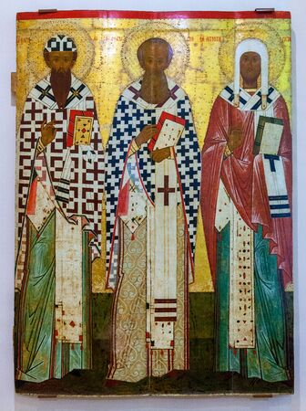 iconography: VELIKY  NOVGOROD, RUSSIA - JULY 24, 2014: Antique Russian orthodox icon of SS Cyril and Athanasius of Alexandria, Leontius of Rostov painted on wooden board