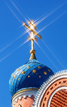 orthodox church: Dome of Russian orthodox church with cross against blue sky
