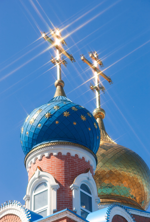 the orthodox church: Domes of Russian orthodox church with cross against blue sky